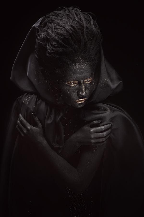 Black woman in black coat