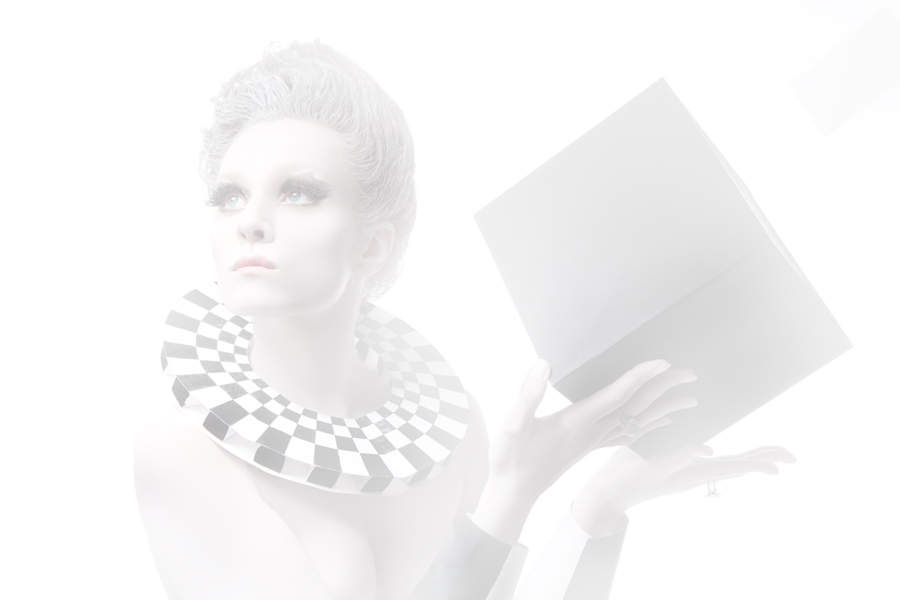 White woman with cube